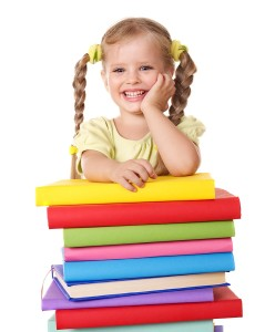 Little-girl-holding-pile-of-books